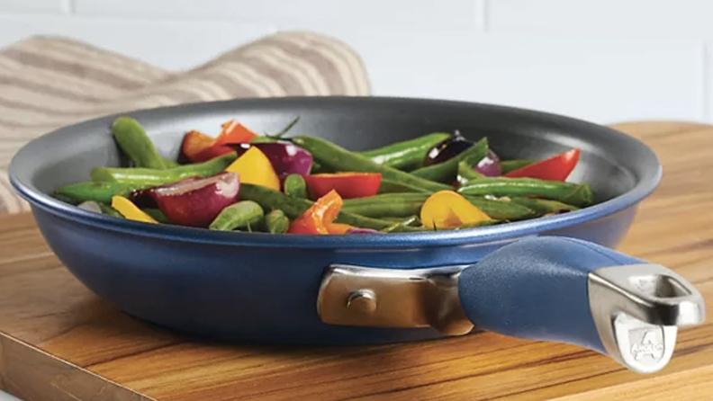 A blue skillet full of veggies
