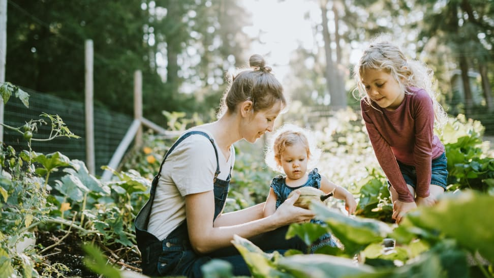 Mother in garden with two kids