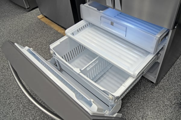 The Kenmore Elite 74025's tilt-down door makes it easy to access the freezer drawers, as long as you have the kitchen space for a full extension.