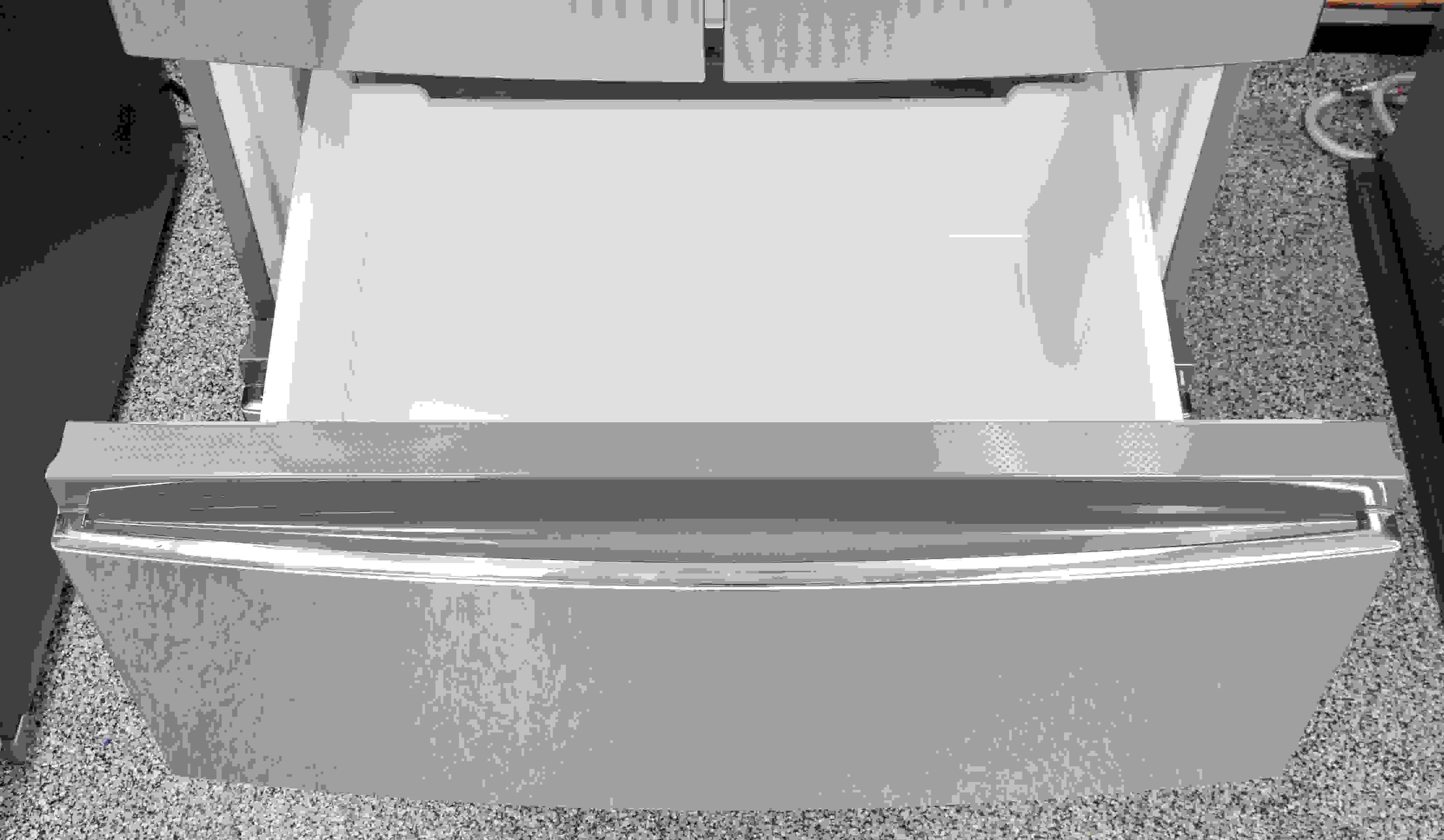 The Haier HRF15N3AGS's upper freezer bin is basically a large sliding bucket.