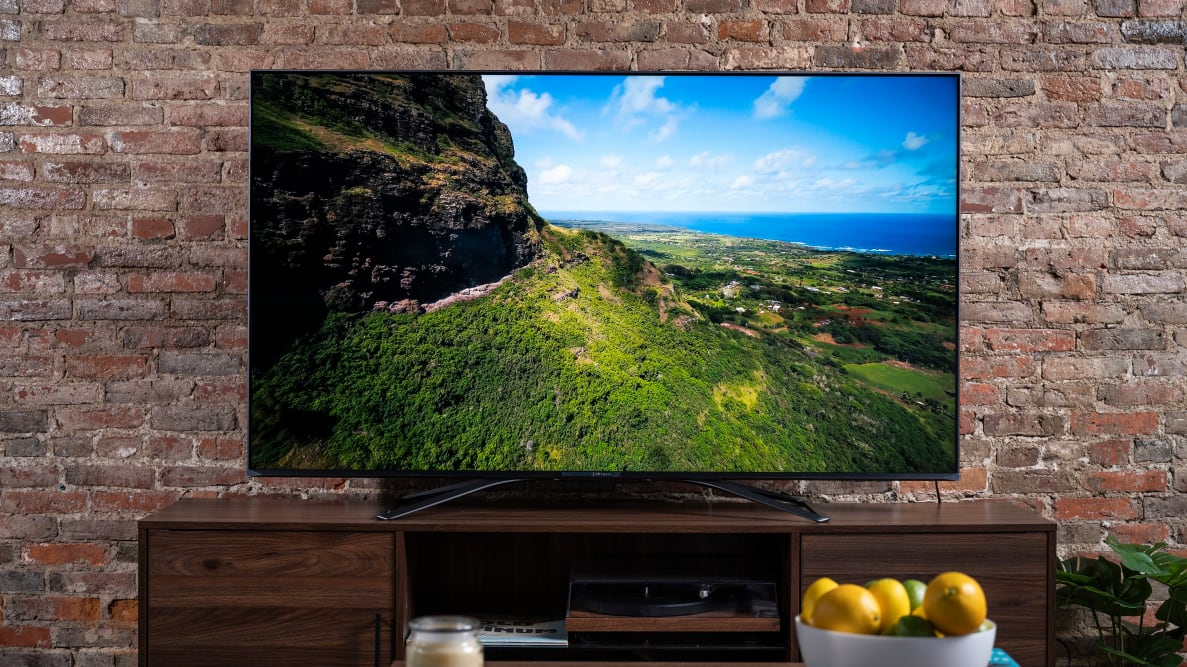 The 65-inch Hisense U8G displaying 4K/HDR content in a living room setting
