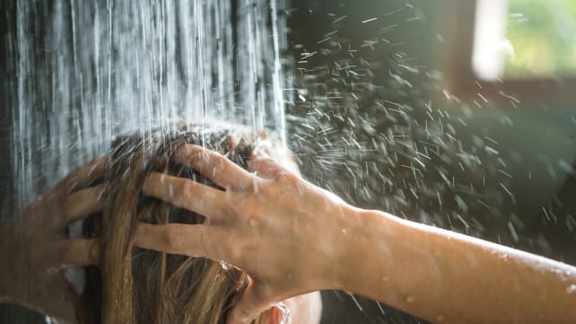 There's a gross reason you should be showering at night - showering top of head