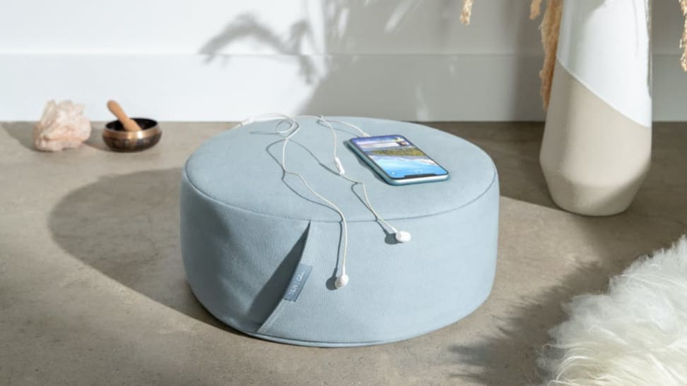 Meditation pillow with phone on top