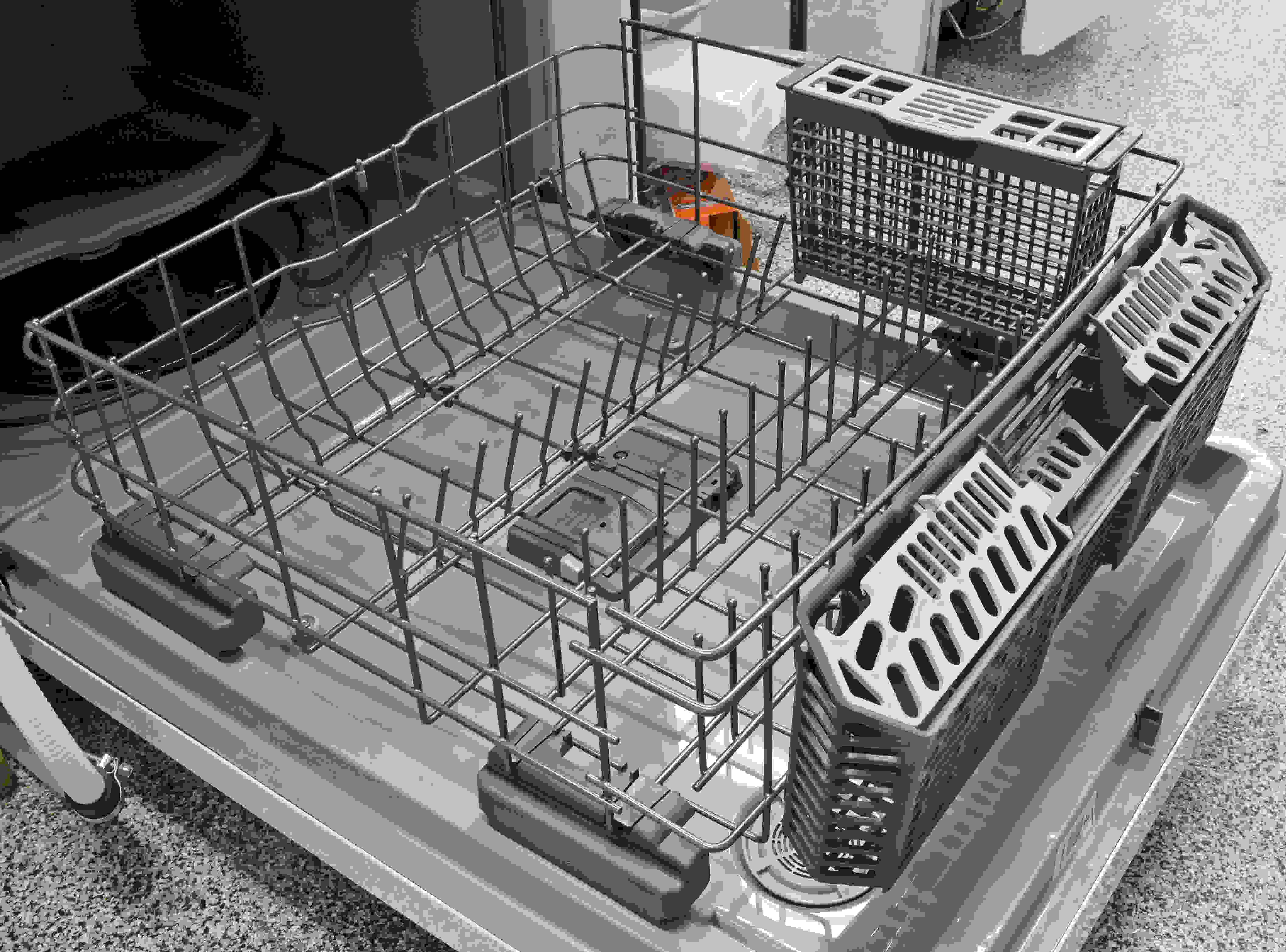 Nothing fancy on the lower rack, except for the unusual sight of dueling cutlery baskets—neither of which blew us away.