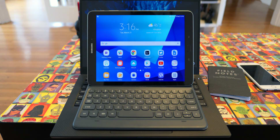 Samsung Galaxy Tab S3 on top of laptop