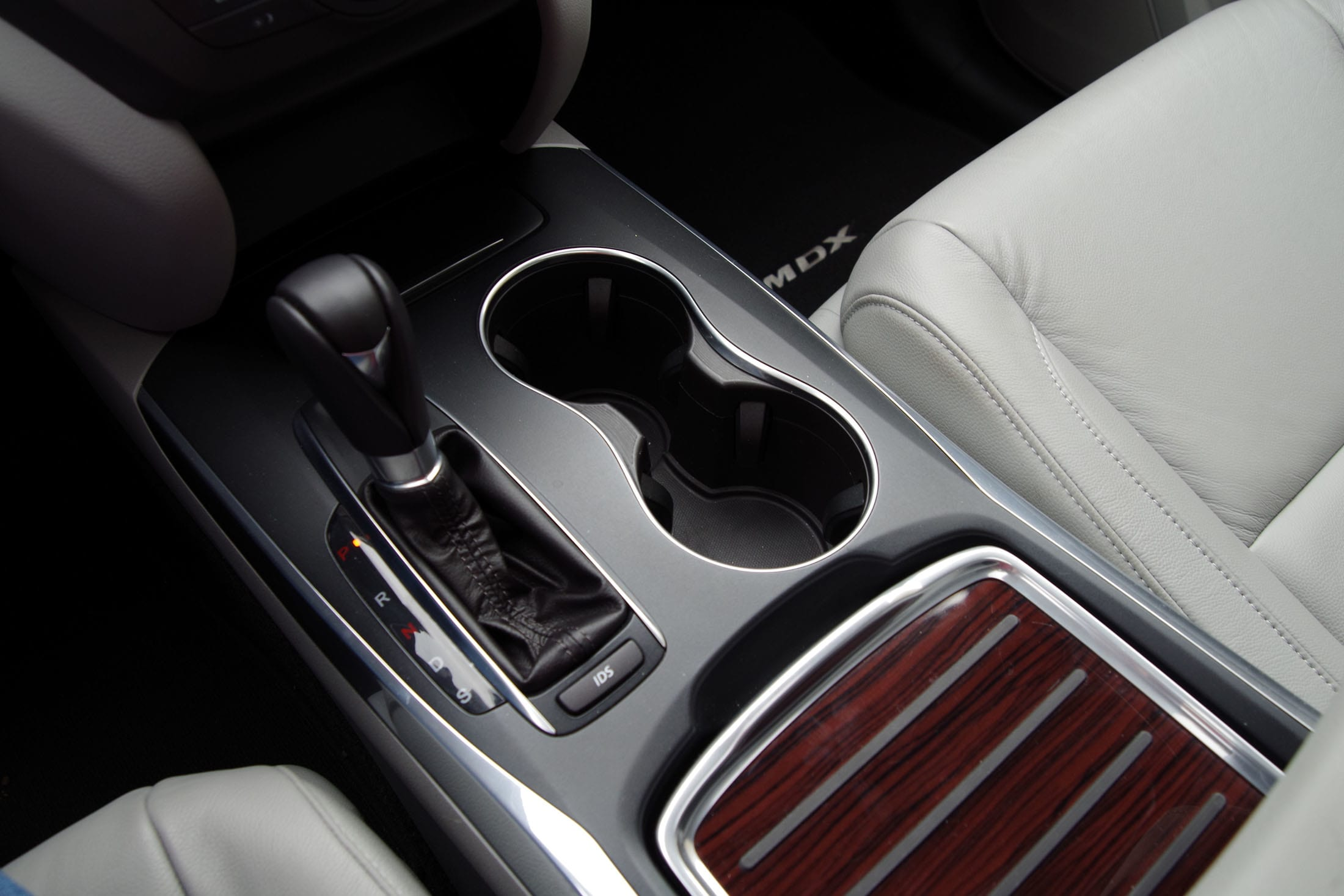The 2014 Acura MDX comes with two cupholders and a cavernous center storage console.
