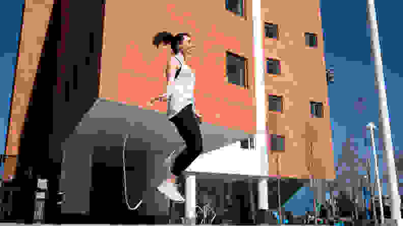 Woman jumping rope with crossrope weighed jump rope.