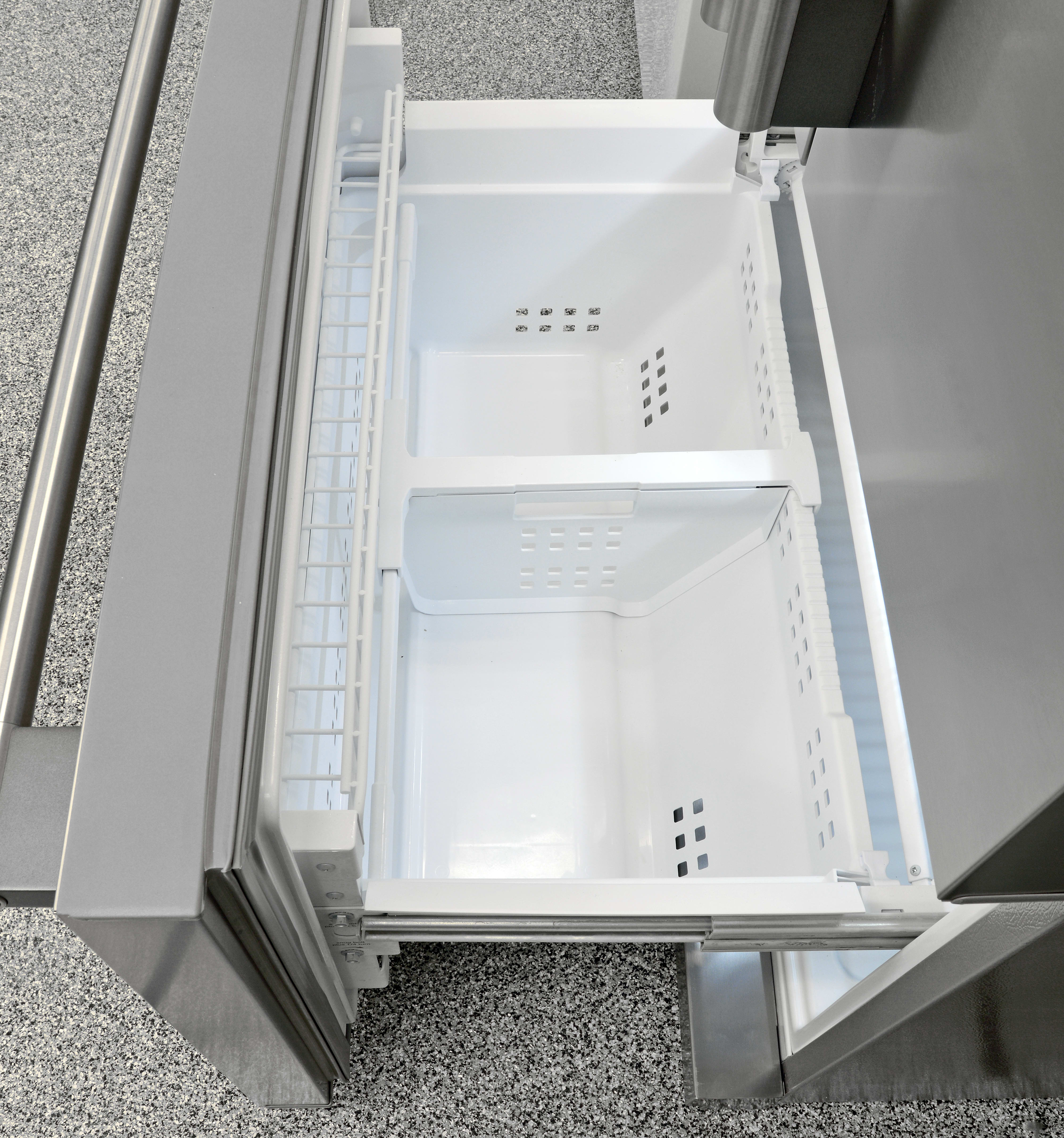 The divider found in the bottom section of the Frigidaire Professional FPBC2277RF's freezer is adjustable. Also, notice the small shelf just inside the door.