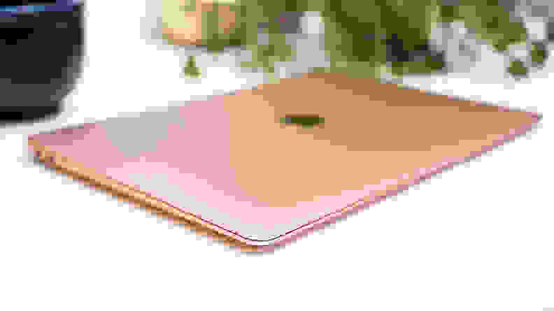 Close-up: a rose-gold MacBook Air, largely out of focus.