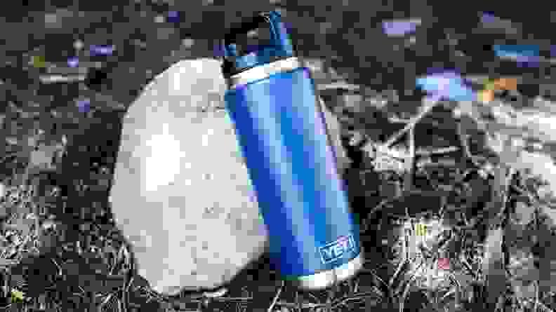 Yeti Rambler Bottle on a rock