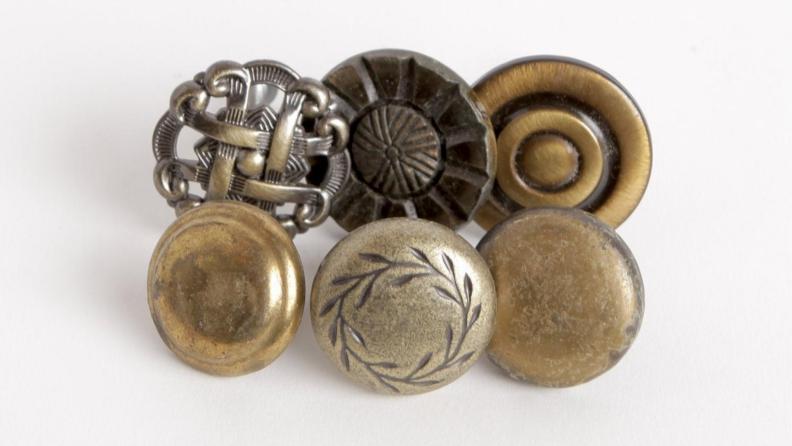 Six different unique brass knobs