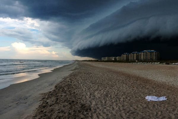 Felicia Pandola's shot of a storm rolling over a city won first place in the nature category. [Credit: Felicia Pandola/IPPA]