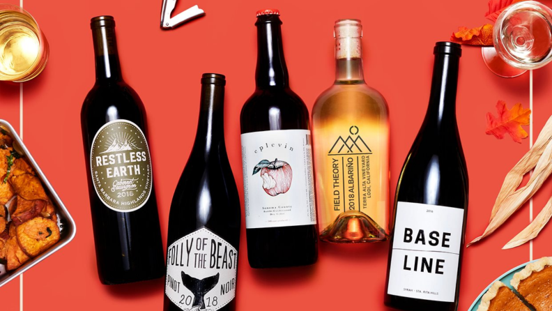 Five wine bottles on a red background