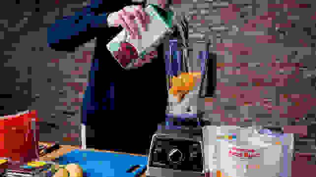 Adding milk to blender