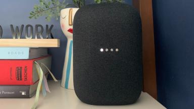 Google's Nest Audio smart speaker sits on a shelf.