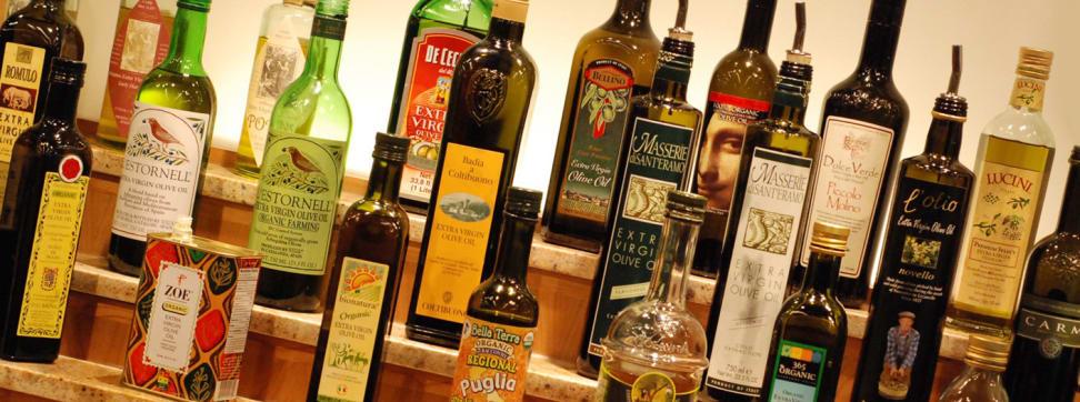 A shelf full of olive oils.