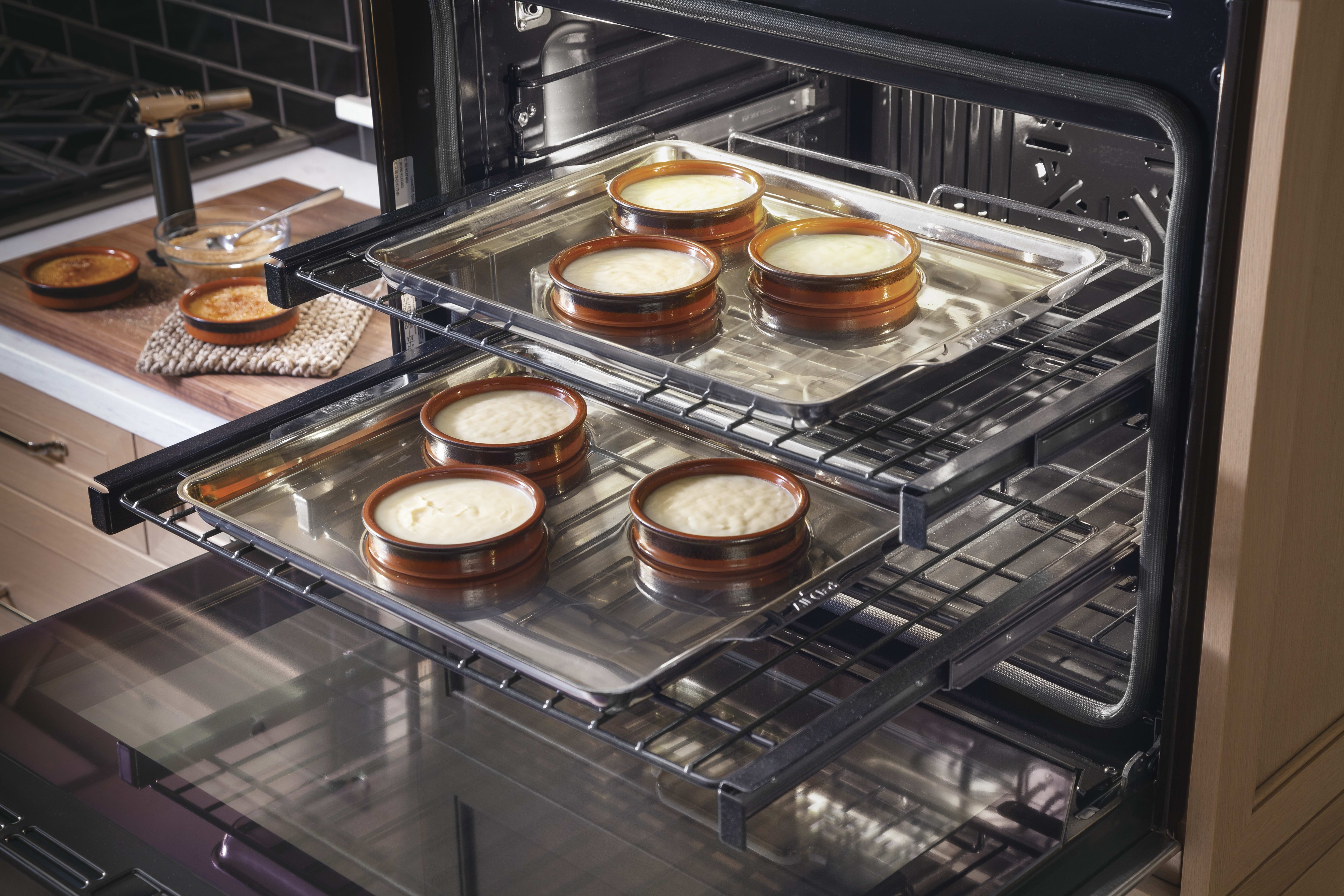 Two smooth-sliding oven racks are self-clean-safe.