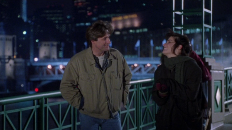 A still from 'While You Were Sleeping' featuring Bill Pullman and Sandra Bullock.
