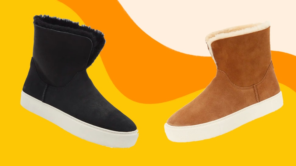 Black and tan UGG boots against a colorful background.