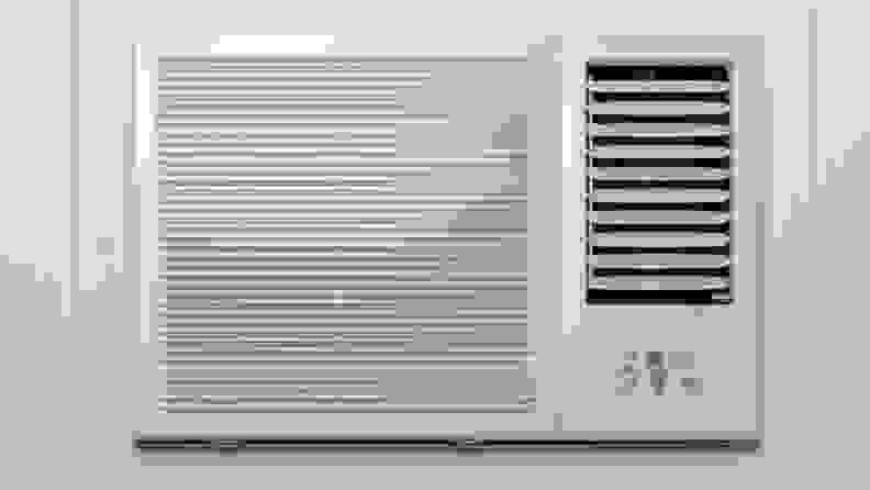 A traditional A/C unit, installed in a window.