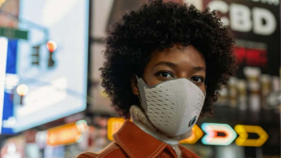 AirPop Active + smart face mask on a woman in a city