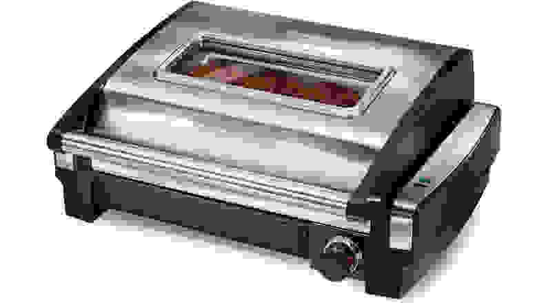 A silver  Hamilton Beach Searing Grill with Window viewed from a front left angle.