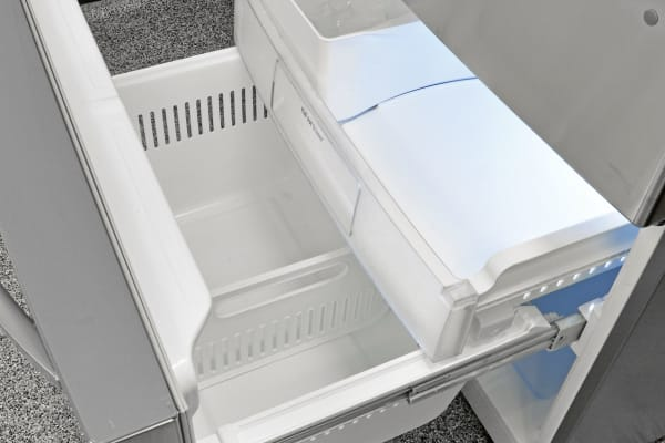 The LG LDCS24223S's pullout freezer is roomy, but we had a hard time keeping the door open when putting food in or taking it out.