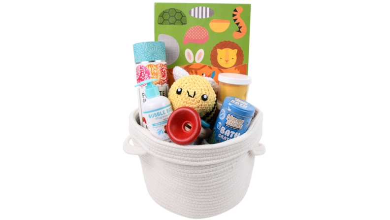 This toddler-friendly white Easter basket includes a stuffed toy bumble bee, bubble bath, and bath crayons.