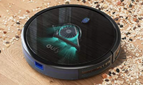 A robot vacuum cleaning up dirt on a wood floor