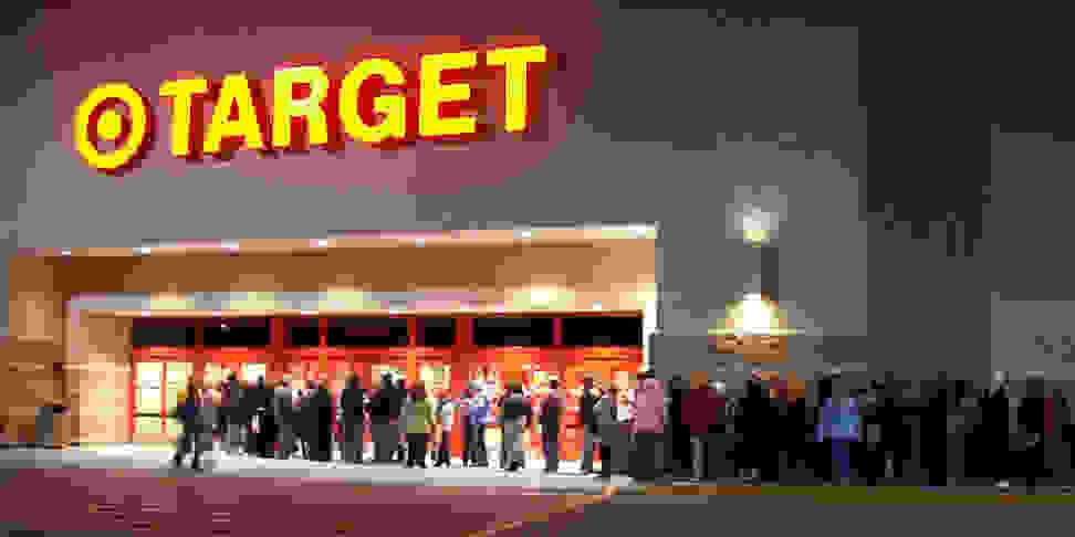 Customers line up outside a Target store on Black Friday