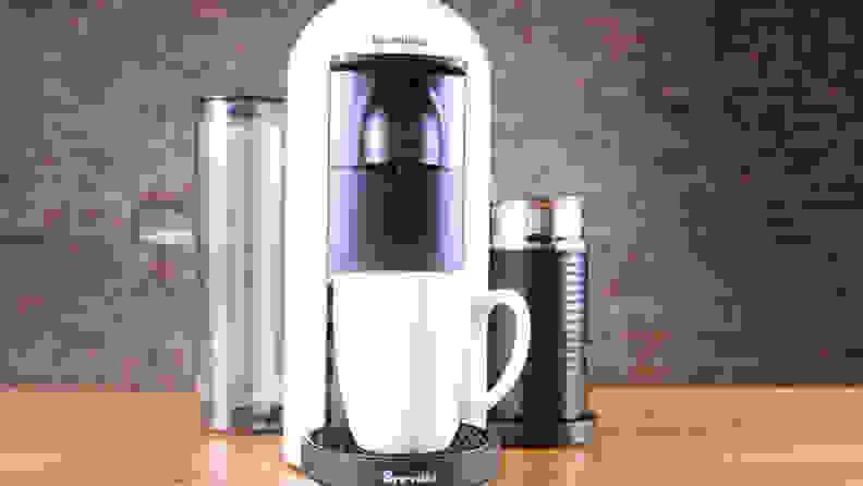 A white Nespresso VertuoPlus single-serve coffee maker.