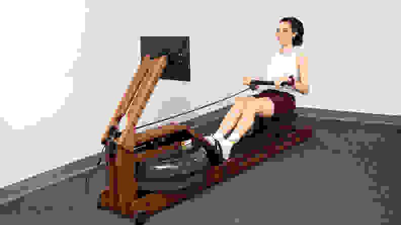 Woman rowing on Ergatta rowing machine.