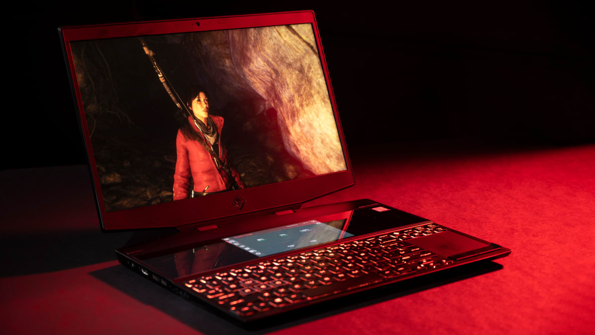 The HP Omen X 2S gaming laptop on a red and black background