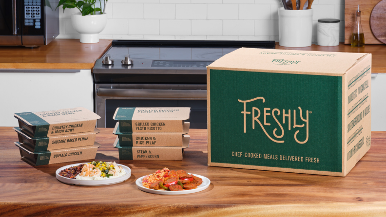 Individually packaged meals from Freshly on countertop in kitchen.