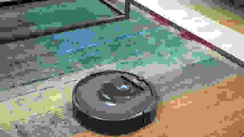 The iRobot Roomba i7+ cleaning a carpet
