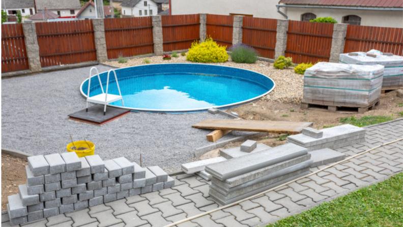 In ground pool backyard