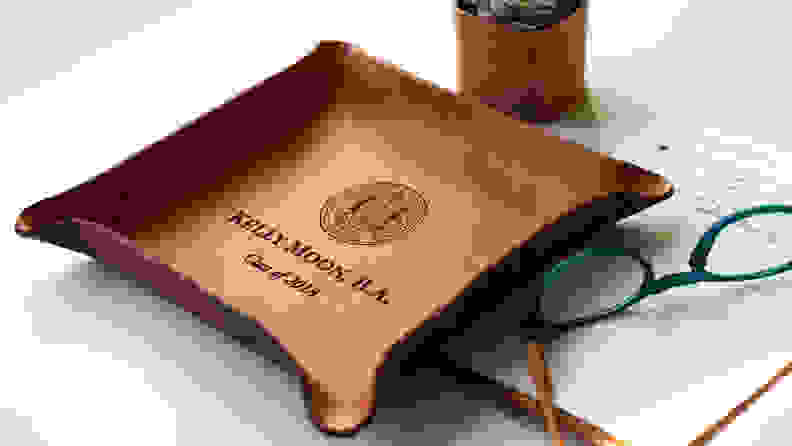 brown customized leather tray with college seal