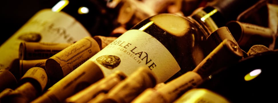 A bottle of wine with corks.