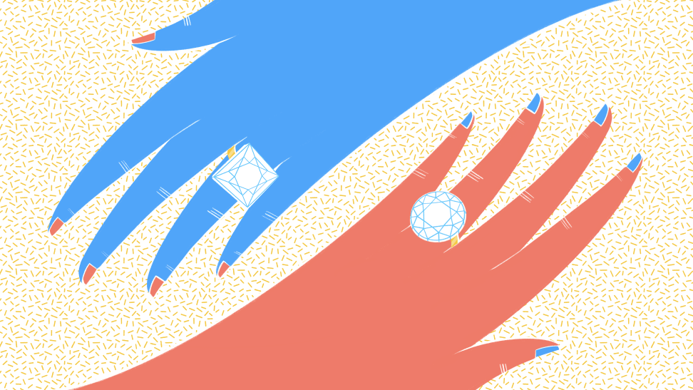 A blue hand and red hand wearing engagement rings