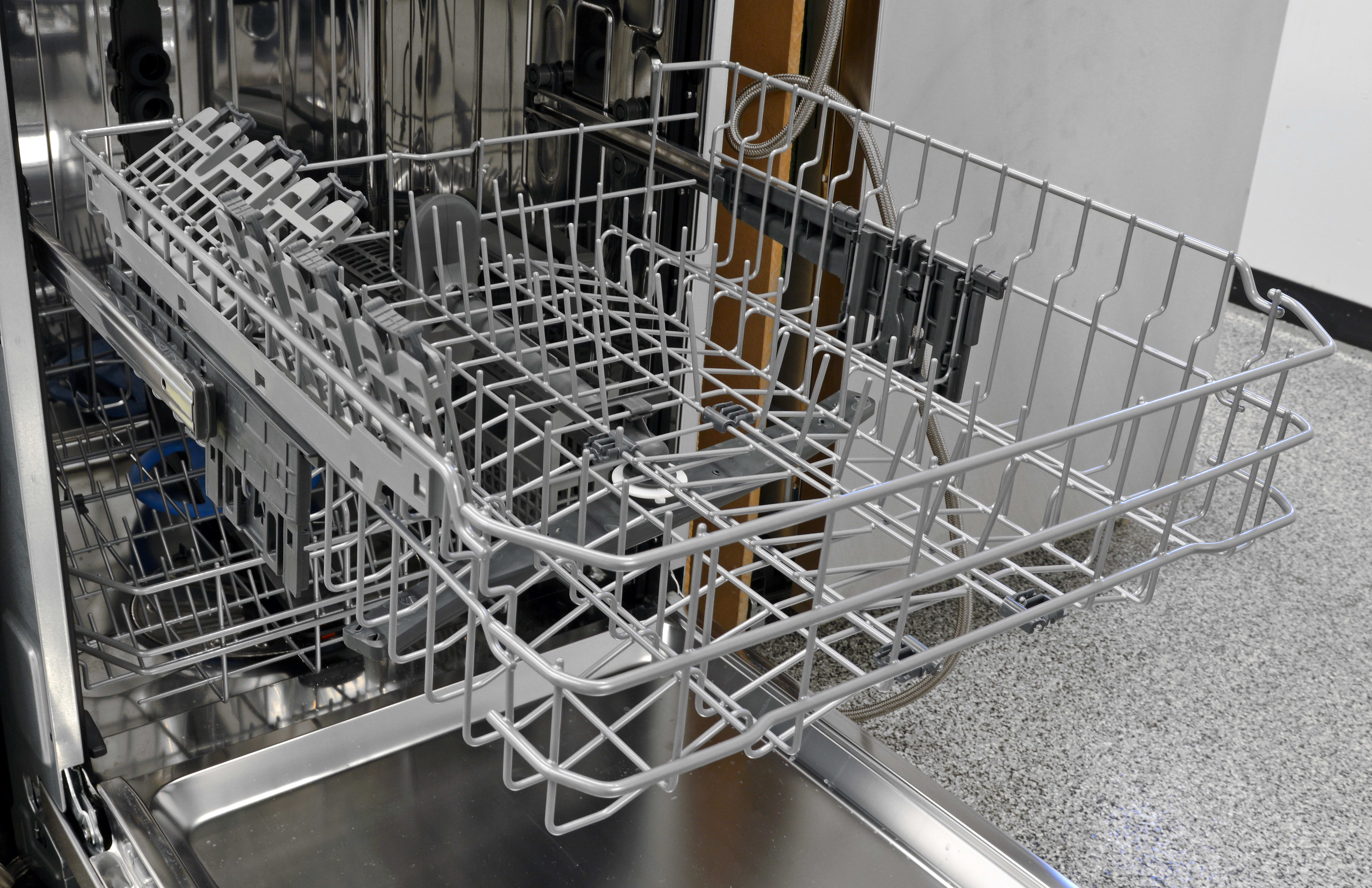 The upper rack not only gets adjustable tines and stemware holders, you can also adjust the height by lifting it into place.
