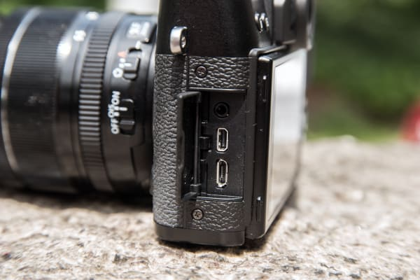 The X-T10 has connections for micro USB, micro HDMI, and external microphones.