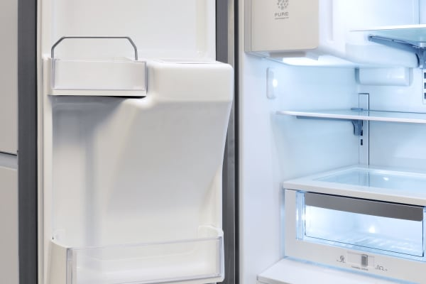Models with through-the-door dispensing get a rather bulky internal ice maker, as well as adjusted door shelving to accommodate it.