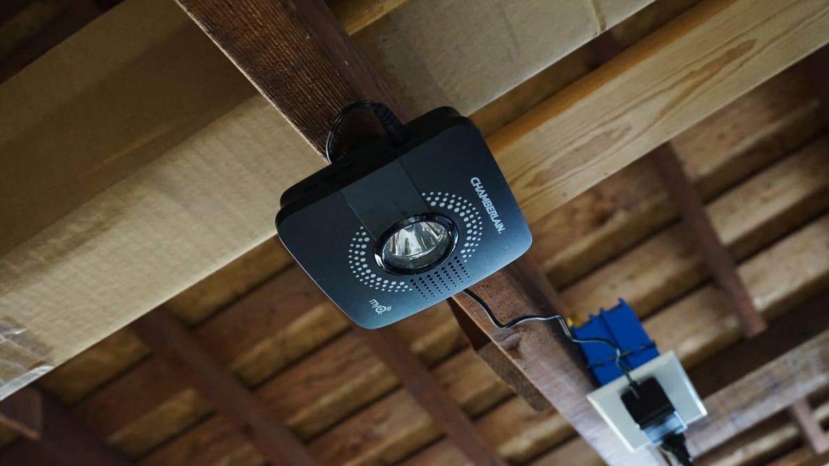 Chamberlain MyQ Smart Garage Hub mounted on beam in garage