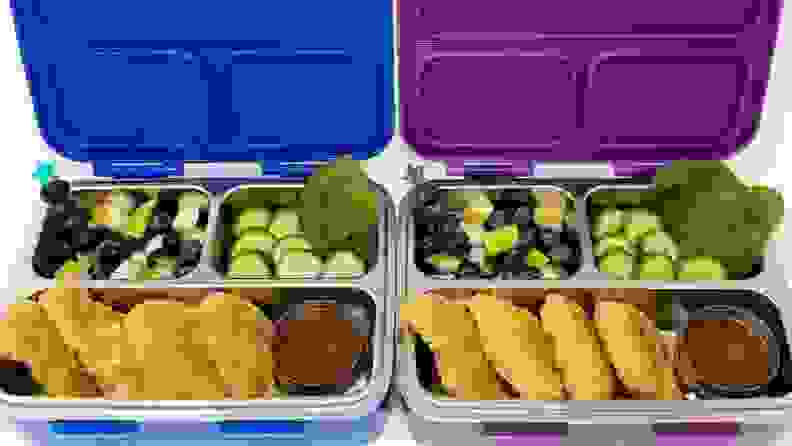 chicken nuggets in a blue and a purple bento lunchbox.