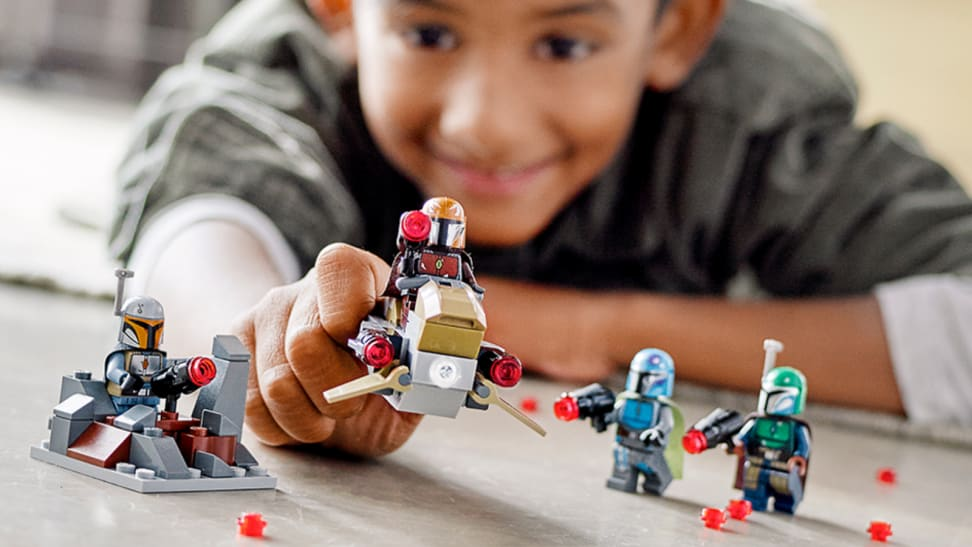 Boy playing with lego figures