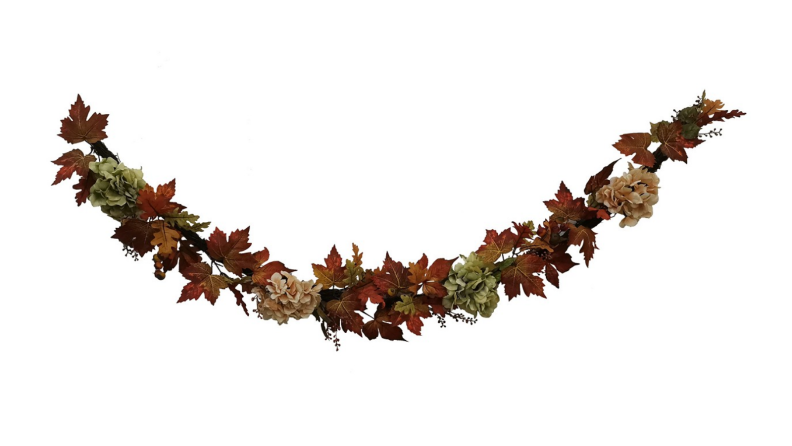 An image of a dark-toned garland with dried leaves.