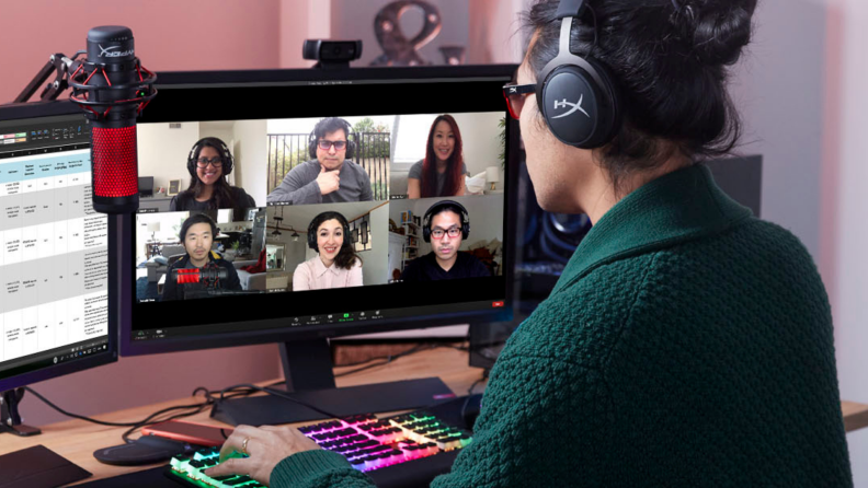 A person live streams wearing a headset while corresponding with other players.
