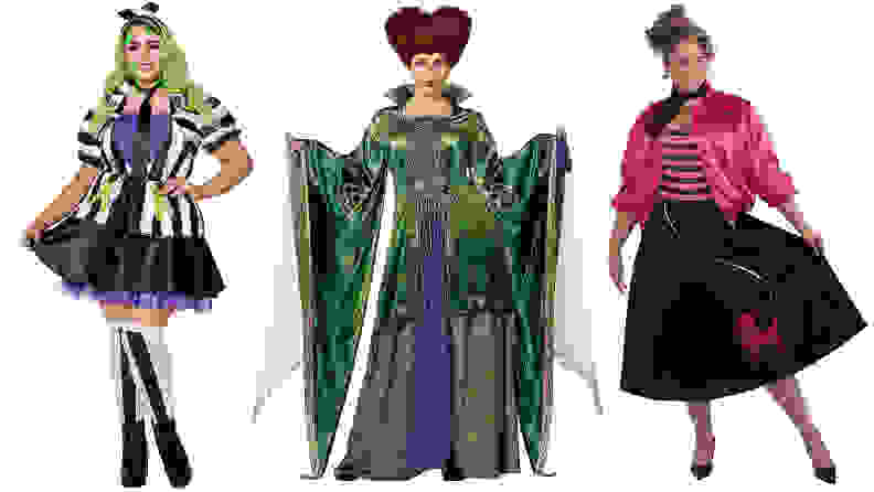 Three women standing next to each other wearing costumes: Beetlejuice, the witch from Hocus Pocus, and a 1950s girl