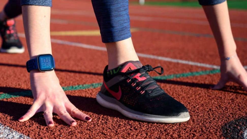 A woman wearing Nike running shoes on a track