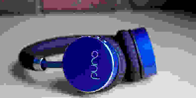 A pair of blue Puro BT2200 headphones lying on their side.